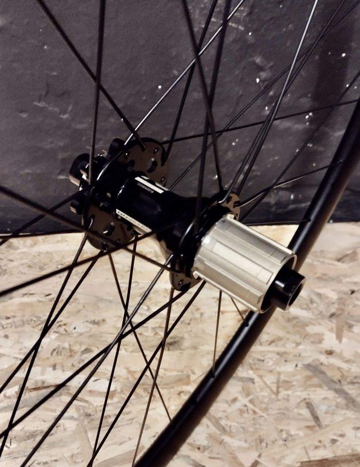 """Tylna piasta Novatec 792 oś x12mm hamulec tarczowy na 6 śrub w lekkim kole aluminiowym szosa DT Swiss RR 521 28"""" 29"""" 700C"""